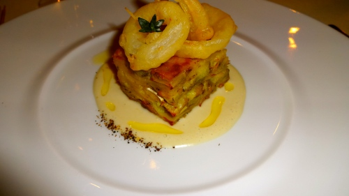 Potato, Baccalà, and Artichoke Millefoglie with Fried Onion Rings.
