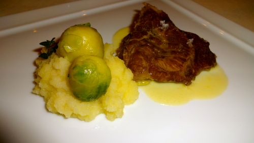 Veal Cheek with Brussel Sprouts and Orange Gorgonzola Sauce.