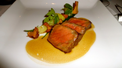 Steak, Chanterelle Mushrooms, and Confited Potatoes.
