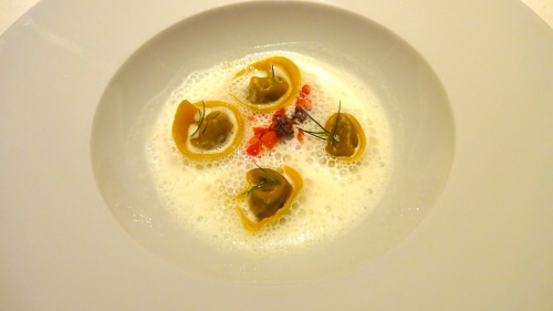 Game-filled Tortelli with Tomato Confit, Taggiasche Olives, and Parmesan Foam.