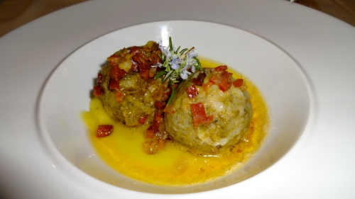 Canederli: Bread Dumplings with Speck and Leek Sauce.