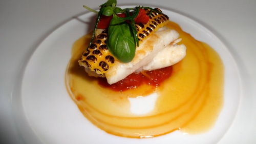 John Dory Fish Cooked a la Plancha with Corn and Tomato Dashi Butter.