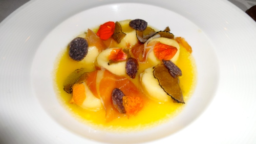 Smoked Potato Gnocchi with Prosciutto, Confited Truffle, and Parmigiano.