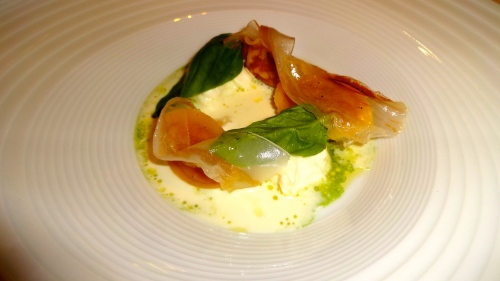 Tomato Ravioli with Burrata, Guanciale, and Basil.