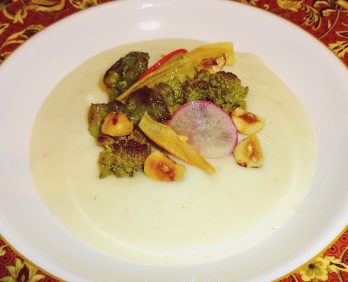 Cauliflower Soup with Braised and Roasted Brassicas, Pickled Radishes, Brown Butter Hazelnuts, and Parsnip Chips.