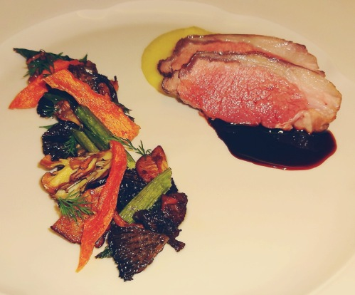 Roasted Lamb Loin with Green Garlic Polenta, Roasted Mushrooms and Asparagus, Carrot Chips, and Fresh Dill.