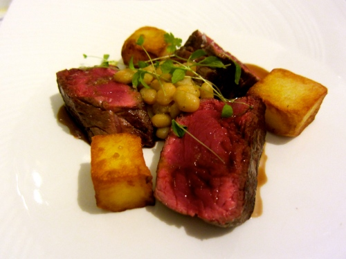 Beef Tagliata with Roasted Potatoes and Zolfini Beans.