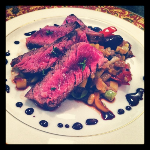 Seared Rib-eye Steak with Summer Squash Caponata and Red Wine Reduction.