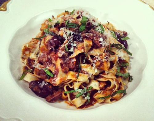 Handmade Mint Tagliatelle with Lamb Ragu, Black Olives, and Walnuts.