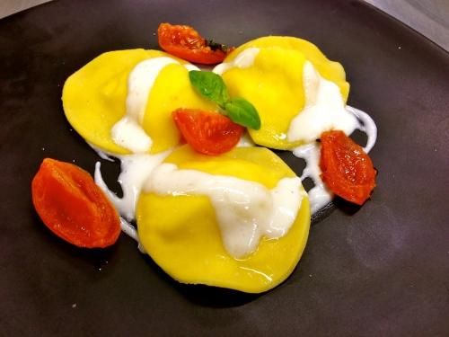 Ravioli with Parmigiano Fondue and Tomatoes.