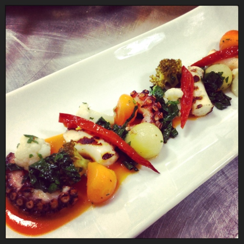 Grilled Octopus with Marinated Vegetables and Tomato Coulis.