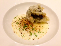 Tempura Artichokes stuffed with Taleggio Cheese with Potato Foam and Licorice Powder.