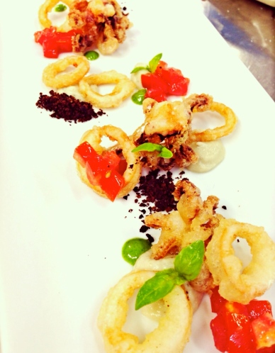 Fried Calamari with Spicy Eggplant Cream, Tomato Relish, and Black Olive Powder.