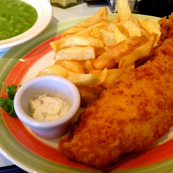 Fish N' Chips with a Side of Mushy Peas at Poppies.