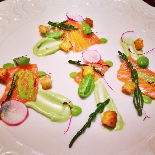 Salmon Crudo with Avocado Crema, Sea Beans, Watermelon Cucumbers, Chili Croutons, and Salsa Verde.