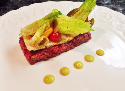 Beef Tartare with Crunchy Bread, Little Gem Lettuce Salad, and Bagna Cauda Mayonnaise.