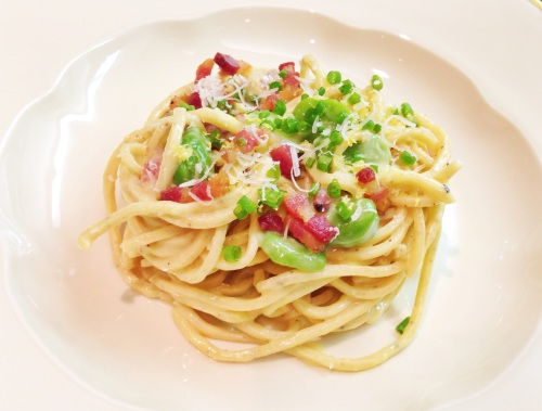 Handmade Black Pepper Chitarra Pasta all Carbonara with Fava Beans.