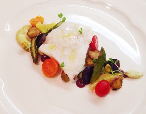 Poached Halibut with Pistachio Cream, Mixed Vegetables, Meyer Lemon, and Black Olive Sauce.