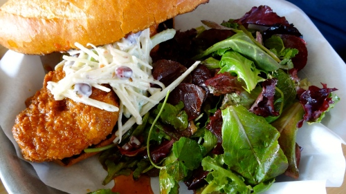 Fried Chicken Sandwich with Apple and Celery Slaw and Pomegranate.