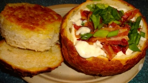 Clam Chowder with Bacon and Green Onions in a Bread Bowl.
