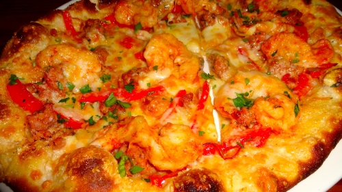 Prawn and Chorizo Flatbread with Red Bell Peppers, Red Onions, and Manchego Cheese (8/10).