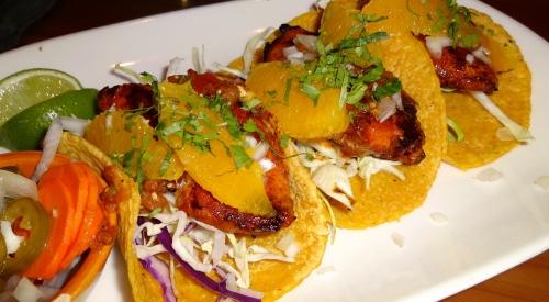 Tacos de Pescado al Pastor: Fish Tacos in Ancho Chili Adobo, Orange, and Salsa de Morita and Tomatillo (8/10).