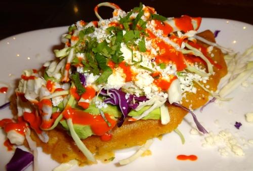 Empanada con Deshebrada de Res: Fried Masa Pastry with Beef, Jalapeño, Cabbage, Avocado, Queso Fresco, and Salsa Frita de Guajillo (8/10).