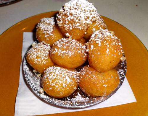 Loukoumades: Traditional Greek Doughnuts with Cinnamon and Honey (8/10).