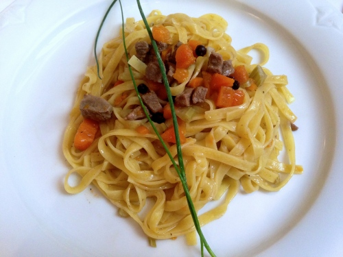 Homemade Tagliatelle with Duck, Carrots, and Juniper.