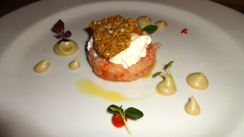 Red Prawn Tartare with Burrata Cheese, Smoked Eggplant Cream, Candied Tomatoes with Mustard, and Pistachio Cookie (8/10).