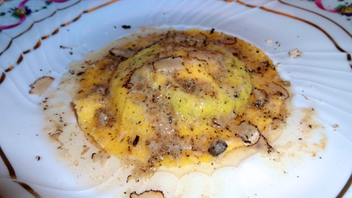 "Their Famous Uovo in Ravioli ""San Domenico"": Spinach and Ricotta Cheese Ravioli with Egg Yolk with Butter, Parmigiano Reggiano Cheese, and Black Truffles (8.5-9/10)."