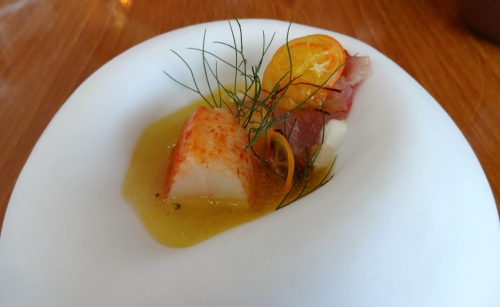 Lobster and Lobster Crudo with White Sesame, Kumquat, and Lobster Saffron Herb Broth (9/10).