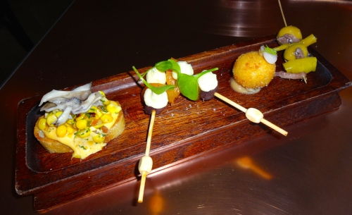 Pintxos: Corn Toast with Chorizo Aioli (8/10), Aprium and Black Olive (7/10), Mushroom Croquette (7/10), and Anchovy and Green Olive (7/10).