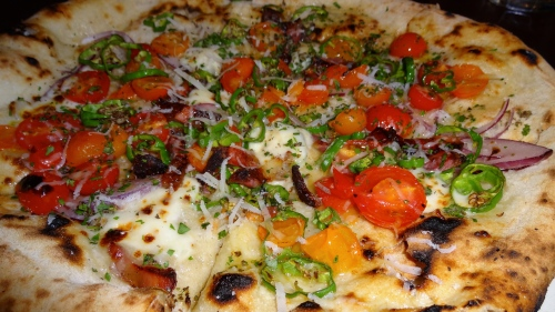 Pizza with Cherry Tomatoes, Padron Peppers, Guanciale, and Grana Padano Cheese (8.5-9/10).