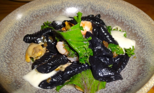 Squid Ink Conchiglie with Spicy Capers, Clams, Calamari, Shrimp, and Greens (8.5/10).