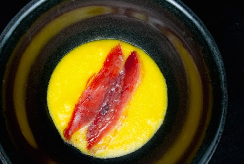 Fresh Corn Grits and House Cured Duck Prosciutto.