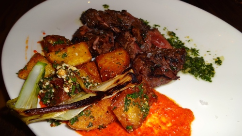 Grilled Hanger Steak with Salsa Verde, Patatas Bravas, Romesco, and Cotija Cheese (8/10).