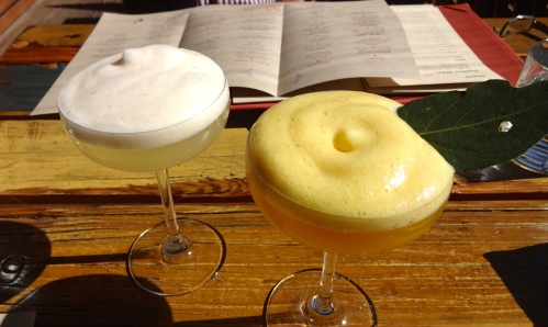 "Left: Right: ""Princesa de la Maracuya"" Mezcal with Orange, Fresno, Laurel, Passionfruit, and Ginger Espuma"
