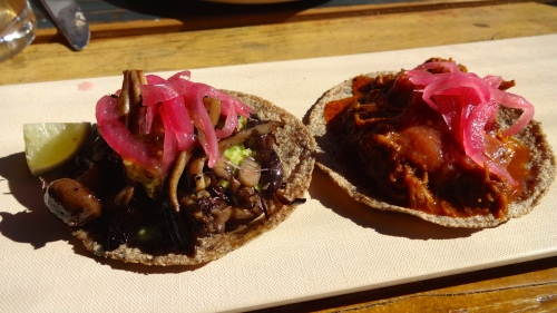 Left: Wild mushroom with Guacamole Verde, and Salsa verde Cocida Taco () and Mayan Axiote Rub Baby Pig Taco (8/10).