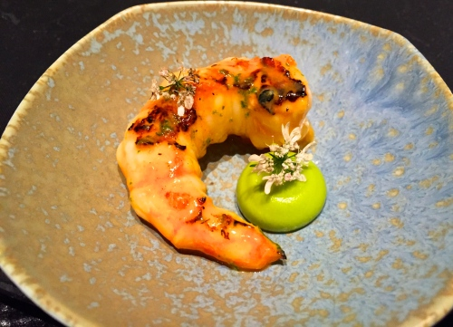 Grilled Spot Prawn with Aji Amarillo Sauce, Avocado Cream, and Cilantro Blossoms.
