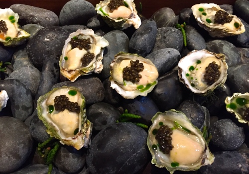Kumamoto Oysters with Smoked Tomato, Tomato Water Mignonette, Tomato Leaf Oil, and Caviar.