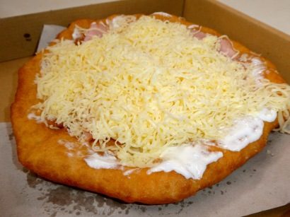 Lángos: Hungarian Fried Dough with Sour Cream, Ham, and Cheese.